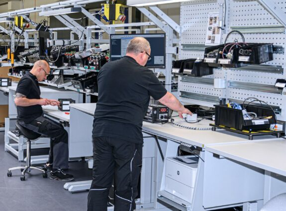 Workers on Ergonomic Stations